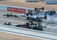 Nov 11, 2018; Pomona, CA, USA; NHRA top fuel driver Steve Torrence (far) defeats father Billy Torrence during the Auto Club Finals at Auto Club Raceway. Mandatory Credit: Mark J. Rebilas-USA TODAY Sports