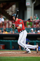 Erie SeaWolves catcher Grayson Greiner (21) follows through on a swing during a game against the Hartford Yard Goats on August 6, 2017 at UPMC Park in Erie, Pennsylvania.  Erie defeated Hartford 9-5.  (Mike Janes/Four Seam Images)