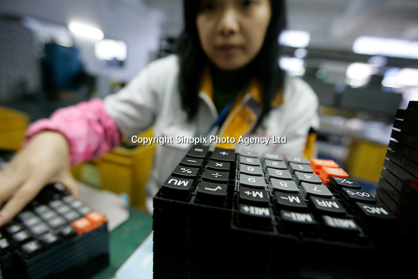 A factory that manufactures electronic calculator in Dongguan, China. Factories in China cranked up production on signs of improving global demand.