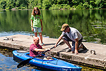 BEACON FALLS, CT. 13 July 2019-071319 - Rebecca Armstrong, 10, of Beacon Falls, left, looks on as she watches her father Greg Armstrong, center, get some instruction from Beacon Falls resident Dave Annelli, as he gets in a kayak, during family day at Matthies Park in Beacon Falls on Saturday. Bill Shettle Republican-American