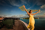 A woman enjoys the carribean breezes while visiting the historic Fort Christiansted in St. Croix, US Virgin Islands