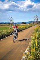Japanese Cyclist on the Rails for Trails Tsukuba Bike Route.  Bicycles are both good exercise and have zero emissions.