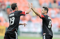 D.C. United midfielder Branko Boskovic (8) celebrates with teammate Emiliano Dudar (19) after making a free kick which resulted in a goal. D.C. United tied The Philadelphia Union 1-1 at RFK Stadium, Saturday August 19, 2012.
