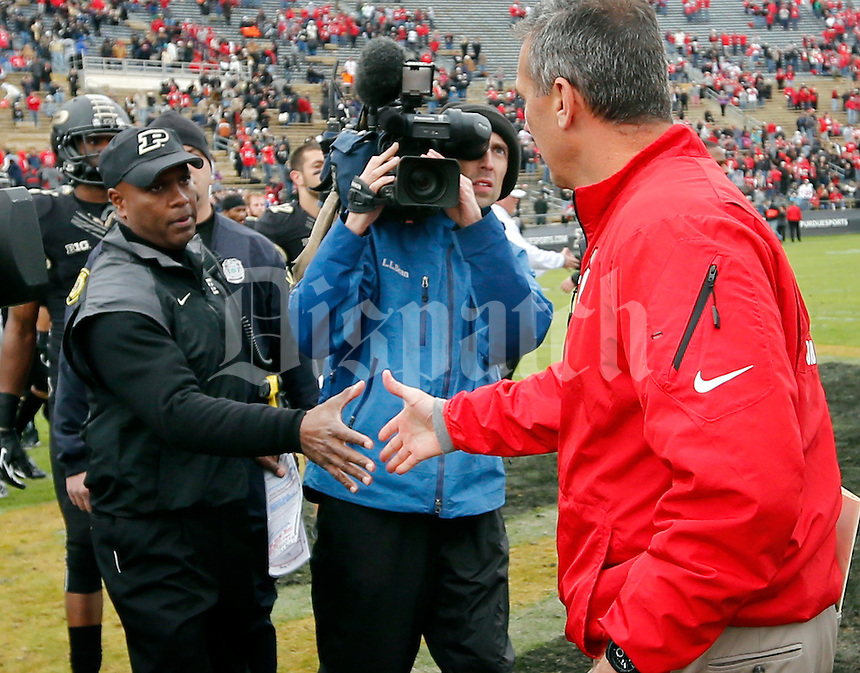 Ohio State Buckeyes head coach Urban Meyer shakes hands with Purdue Boilermakers head coach Darrell Hazell following the Buckeyes' 56-0 win during the NCAA football game at Ross-Ade Stadium in West Lafayette, Ind. on Nov. 2, 2013. (Adam Cairns / The Columbus Dispatch)