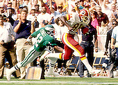 Washington Redskins wide receiver Art Monk (81) runs towards the end zone for a score in the 4th quarter of the game against the Philadelphia Eagles at RFK Stadium in Washington, DC on September 17, 1989.  Eagles defensive back Eric Everett (42) misses in his attempt to make the tackle to stop Monk.  The Eagles won the game 42 - 37.  <br /> Credit: Arnie Sachs / CNP