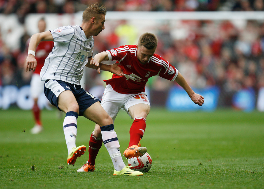 Millwall's Lee Martin (L) and Nottingham Forest's Ben Osborn in action during todays match  <br /> <br /> Photo by Jack Phillips/CameraSport<br /> <br /> Football - The Football League Sky Bet Championship - Nottingham Forest v Millwall - Saturday 5th April 2014 - The City Ground - Nottingham<br /> <br /> &copy; CameraSport - 43 Linden Ave. Countesthorpe. Leicester. England. LE8 5PG - Tel: +44 (0) 116 277 4147 - admin@camerasport.com - www.camerasport.com