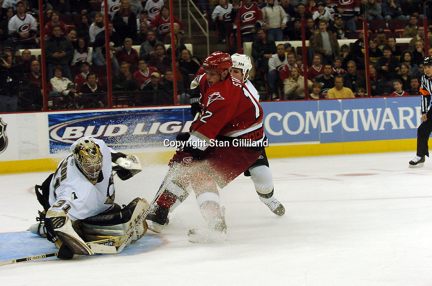 Carolina Hurricanes' Eric Staal is stopped by the Pittsburgh Penguins' goaltender Sebastien Caron and defenseman Ryan Whitney, right, in Raleigh, NC Friday, February 10, 2006. The Penguins won the game 4-3...