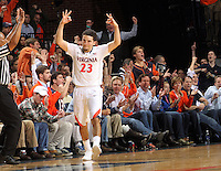 Virginia guard London Perrantes (23) celebrates a 3-point basket during the first half of an NCAA basketball game against North Carolina Monday Jan. 20, 2014 in Charlottesville, VA. (Photo/Andrew Shurtleff)