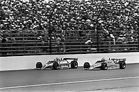 INDIANAPOLIS, IN - MAY 24: AJ Foyt drives his Coyote 81 1/Cosworth ahead of Gordon Johncock in a Wildcat VIII/Cosworth during the Indianapolis 500 USAC/CART Indy Car race at the Indianapolis Motor Speedway in Indianapolis, Indiana, on May 24, 1981.