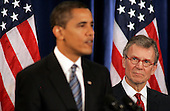 "Chicago, IL - December 11, 2008 -- Tom Daschle, right, listens to United States President-elect  Barack Obama speak at a news conference introducing him as his nominee for Secretary of Health and Human Services directorThursday, December 11, 2008, in Chicago, Illinois. In his remarks, Obama said he was ""appalled and disappointed"" by the revelations this week concerning Illinois Governor Rod Blagojevich's alleged attempts to sell Obama's old United States Senate seat..Credit: Frank Polich - Pool via CNP"