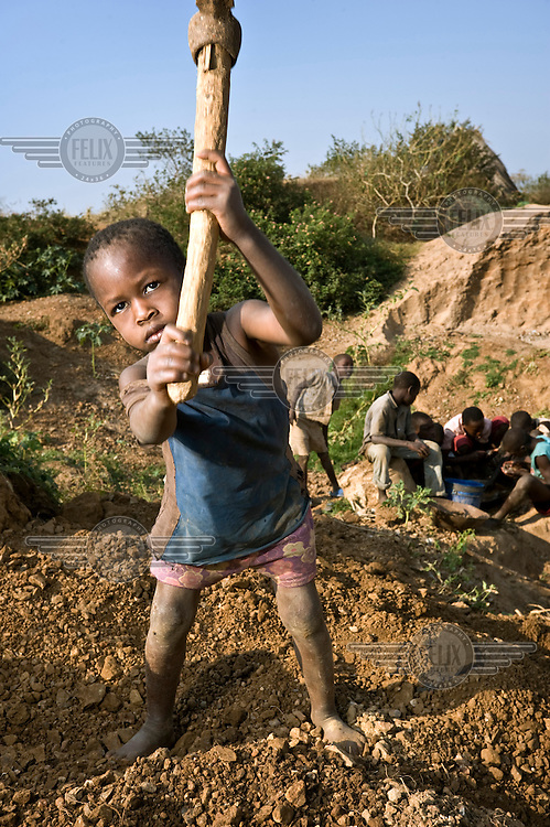 Children working in the gold mines of northern Tanzania smash and wash stones, searching for traces of gold.