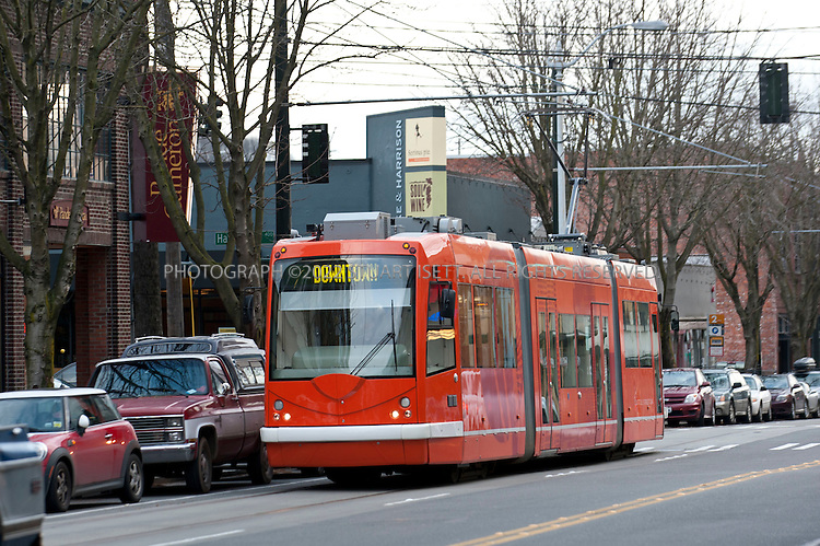 2/20/2011--Seattle, WA, USA..The South Lake Union Streetcar rolls up Westlake Avenue in the South Lake Union neighborhood, heading towards  downtown Seattle. Microsoft tycoon Paul Allen's brainchild of developing South Lake Union into a happening urban village is finally alive and kicking.  This former industrial no-man's-land now houses the city's best galleries, an ever increasing collection of trendy eateries, some nifty shops, and the spanking new Amazon campus. ..©2011 Stuart Isett. All rights reserved.