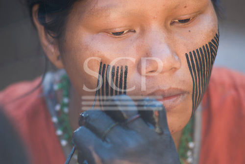 Pará State, Brazil. Aldeia Kokraimoro (Kayapo). Black genipapo facepaint.