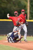 Los Angeles Angels of Anaheim second baseman Andrew Daniel (5) turns a double play as Jake Yacinich (7) backs up the play during an Instructional League game against the Milwaukee Brewers on October 9, 2014 at Tempe Diablo Stadium Complex in Tempe, Arizona.  (Mike Janes/Four Seam Images)