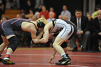 Boyertown's Jakob Campbell (left) and Harry Truman's Gunnar Fuss battle during the 126 pound match Saturday, March 4, 2017 at Souderton High School in Franconia, Pennsylvania. (Photo by William Thomas Cain)