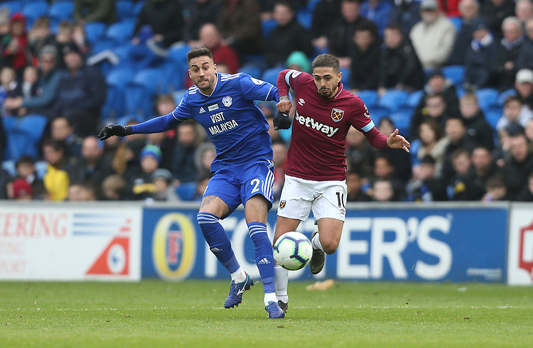 West Ham United's Manuel Lanzini and Cardiff City's Victor Camarasa<br /> <br /> Photographer Rob Newell/CameraSport<br /> <br /> The Premier League - Cardiff City v West Ham United - Saturday 9th March 2019 - Cardiff City Stadium, Cardiff<br /> <br /> World Copyright © 2019 CameraSport. All rights reserved. 43 Linden Ave. Countesthorpe. Leicester. England. LE8 5PG - Tel: +44 (0) 116 277 4147 - admin@camerasport.com - www.camerasport.com