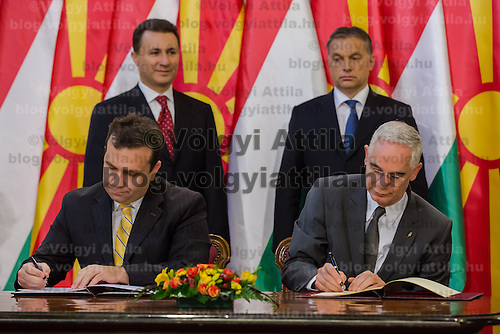 Bil Pavlevski (L) minister of Macedonia and Zoltan Balog (R) minister of National Human Resources for Hungary sign an agreement during a press conference in Budapest, Hungary on November 14, 2012. ATTILA VOLGYI