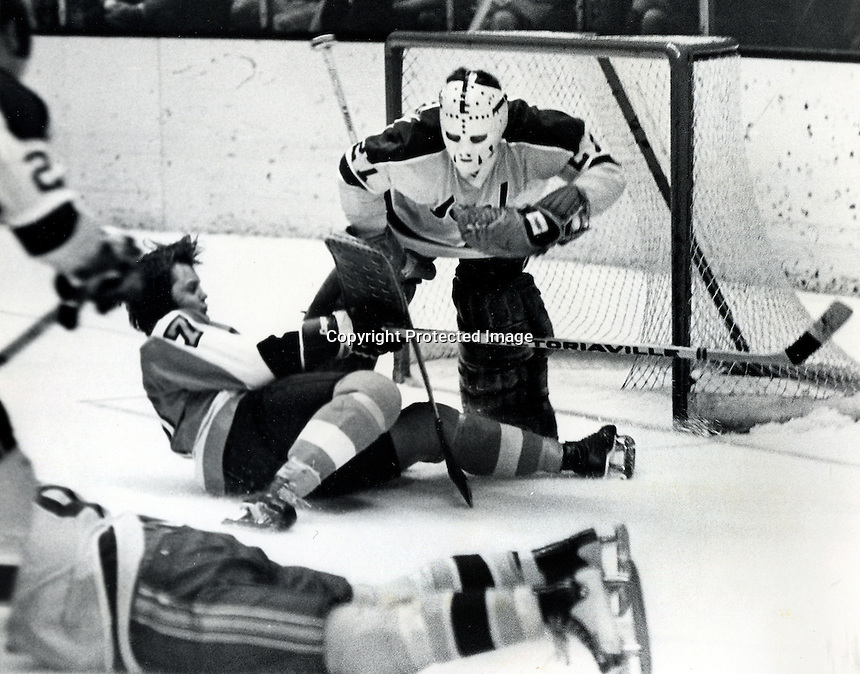 Seals action, Flyer's #7 Bill Barber in front of net guarded by Giles Meloche. (1974 photo by Ron Riesterer)