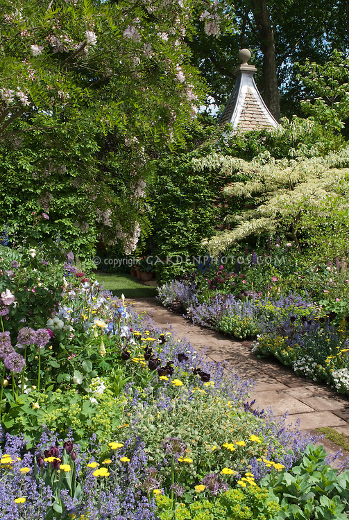 Flower Garden Path beautiful flower garden in late spring | plant & flower stock