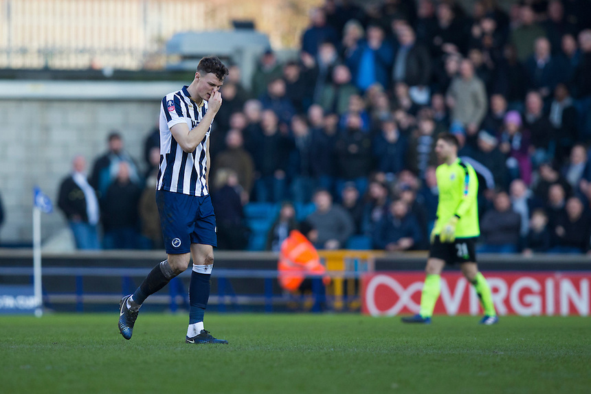 Millwall's Jake Cooper looks dejected after he is sent off<br /> <br /> Photographer Craig Mercer/CameraSport<br /> <br /> Emirates FA Cup Fifth Round - Millwall v Leicester City - Saturday 18th February 2017 - The Den - London<br />  <br /> World Copyright &copy; 2017 CameraSport. All rights reserved. 43 Linden Ave. Countesthorpe. Leicester. England. LE8 5PG - Tel: +44 (0) 116 277 4147 - admin@camerasport.com - www.camerasport.com