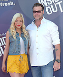 Tori Spelling and Dean McDermott attends The Disney Pixar L.A. Premiere of Inside Out held at The El Capitan Theatre  in Hollywood, California on June 08,2015                                                                               © 2015 Hollywood Press Agency