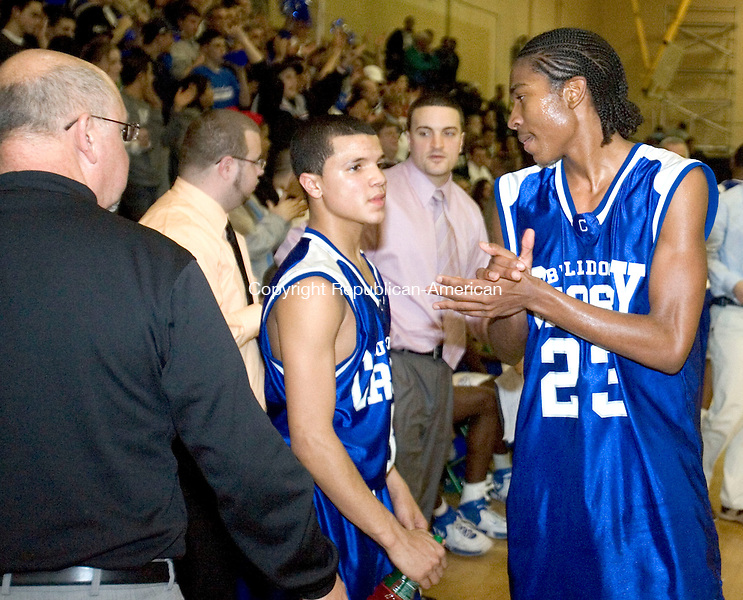 WATERBURY, CT--28 February 2007--022807JS19-Crosby's head coach Nick Augelli, Anthony Ireland and BJ Monteiro celebrate their win over Holy Cross to win the NVL ChampionshipWednesday at Wilby High School in Waterbury. <br /> Jim Shannon / Republican-American