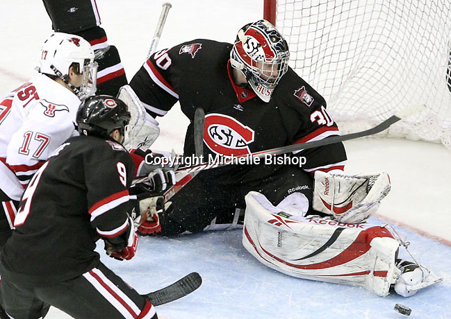 St. Cloud State goalie Mike Lee makes a kick save during the third period. UNO rallied from a 3-0 deficit to beat St. Cloud State 4-3 Saturday night at Qwest Center Omaha.  (Photo by Michelle Bishop)