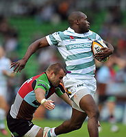 Topsy Ojo looks to race clear of Ross Chisholm on his way to the try-line. J.P. Morgan Premiership Rugby 7s match, between London Irish and Harlequins on July 13, 2012 at the Twickenham Stoop in London, England. Photo by: Patrick Khachfe / Onside Images