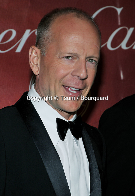 Bruce Willis arriving at the PALMS SPRING Film Festival, Convention Center.<br /> <br /> headshot<br /> smile<br /> eye contact