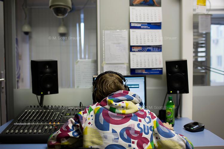 A radio producer works on a piece in the Komsomolskaya Pravda radio studio in Moscow, Russia.