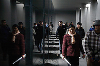 Visitors walk among the exhibits and statues at the Memorial Hall of the Nanjing Massacre in Nanjing, Jiangsu, China on Dec. 13, 2009.  On Dec. 13, 2009, thousands of people visited The Memorial Hall of the Nanjing Massacre in Nanjing, Jiangsu, China, to remember those who died at the hands of Japanese soldiers in 1937-8.  The day marked the 72nd anniversary of the start of the massacre. The historical account has always been mired in controversy, and differing opinions on what actually happened have been a consistent obstacle to relations between China and Japan.  China's official account of history states that 300,000 people were killed by Japanese forces over a 6-week period starting Dec. 13, 1937