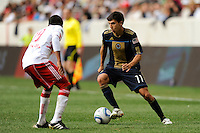 Shea Salinas (11) of the Philadelphia Union is marked by Dane Richards (19) of the New York Red Bulls. The New York Red Bulls defeated the Philadelphia Union 2-1 during a Major League Soccer (MLS) match at Red Bull Arena in Harrison, NJ, on April 24, 2010.