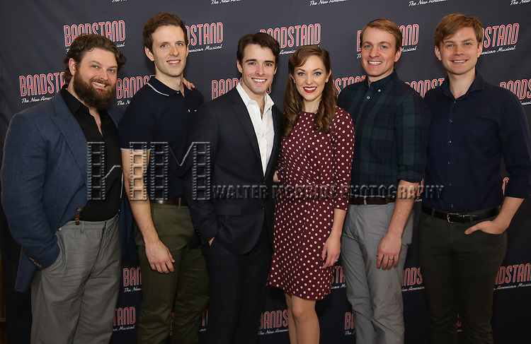 Brandon James Ellis, Joe Carroll, Corey Cott, Laura Osnes, Geoff Packard and James Nathan Hopkins attends the 'Bandstand' Broadway cast photo call at the Rainbow Room on March 7, 2017 in New York City.