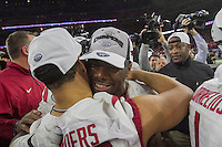 Arkansas Democrat-Gazette/BENJAMIN KRAIN --12/29/14--<br /> Martrell Spaight celebrates with team mates after the Razorbacks Texas Bowl victory over the University of Texas Monday in Houston.