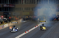 Jul. 20, 2013; Morrison, CO, USA: NHRA top fuel dragster driver Morgan Lucas (right) gets sideways racing alongside Antron Brown during qualifying for the Mile High Nationals at Bandimere Speedway. Mandatory Credit: Mark J. Rebilas-
