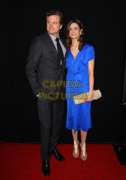 COLIN FIRTH & LIVIA GIUGGIOLI.The 38th Annual Los Angeles Film Critics Association Awards  held at The InterContinental Hotel, Los Angeles, CA, USA, 15th January 2011..full length black tie grey gray suit blue dress married husband wife couple knotted clutch bag beige cream strappy sandals .CAP/ADM/TC.©T. Conrad/AdMedia/Capital Pictures.