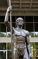 Statue of Enriquillo, a 16th century Taino cacique or chief who rebelled against the Spanish, at the entrance to the Museo del Hombre Dominicano, founded in 1973 and designed by Jose Antonio Caro Alvarez, on the Plaza de la Cultura in the Colonial Zone, in Santo Domingo, capital of the Dominican Republic, in the Caribbean. The museum houses collections on the culture of the Precolumbian Taino people. Santo Domingo's Colonial Zone is listed as a UNESCO World Heritage Site. Picture by Manuel Cohen