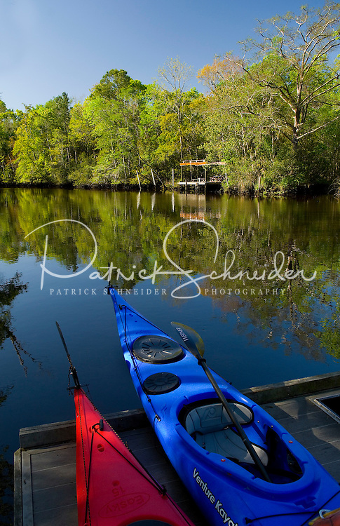 Kayaks sit on a dock waiting to be used in Amelia Island, FL
