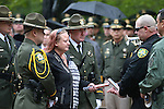 Carson City Sheriff&rsquo;s Deputy Dan Jones, right center, gives a baton to fallen Dep. Carl Howell&rsquo;s widow Rachel during the annual Law Enforcement Officers Memorial Ceremony on the Capitol grounds in Carson City, Nev. on Thursday, May 5, 2016. The name of Carson City Sheriff's Deputy Carl Howell was added to the memorial after he was killed in the line of duty in Aug. 2015.<br />