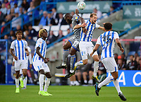 Lincoln City's John Akinde vies for possession with  Huddersfield Town's Jon Gorenc Stankovic<br /> <br /> Photographer Andrew Vaughan/CameraSport<br /> <br /> The Carabao Cup First Round - Huddersfield Town v Lincoln City - Tuesday 13th August 2019 - John Smith's Stadium - Huddersfield<br />  <br /> World Copyright © 2019 CameraSport. All rights reserved. 43 Linden Ave. Countesthorpe. Leicester. England. LE8 5PG - Tel: +44 (0) 116 277 4147 - admin@camerasport.com - www.camerasport.com