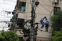 Will's Yoga and Fitness center (www.willsgym.com) 555 Gubei Road (tel 6241 4972) and electronics store next door and guys pulling electrical power lines by hand across the street from the gym.