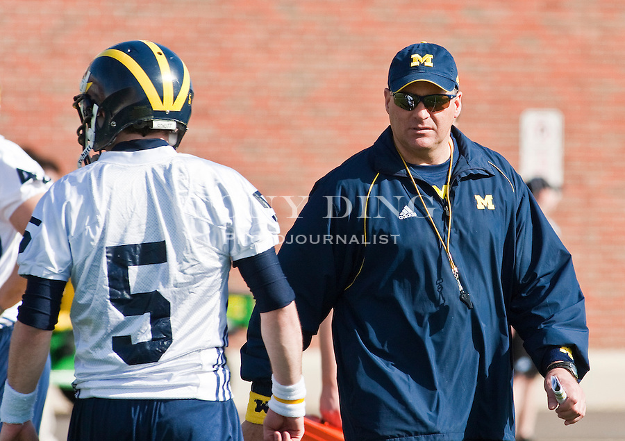 Michigan head coach Rich Rodriguez watches quarterback Tate Forcier (5) during drills on the first day of spring football practices, Tuesday, March 16, 2010, in Ann Arbor, Mich. (AP Photo/Tony Ding)