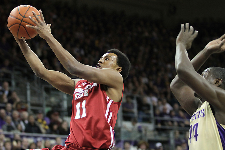 Faisel Aden (#11), Washington State junior guard, drives to the hoop drives past Darnell Gant (#44) during the Cougars 80-69 road victory over arch-rival Washington at the Alaska Airlines Arena in Seattle, Washington, on February 27, 2011.  With the victory, Aden and the Cougars swept the regular season series from the Huskies, two games to none.
