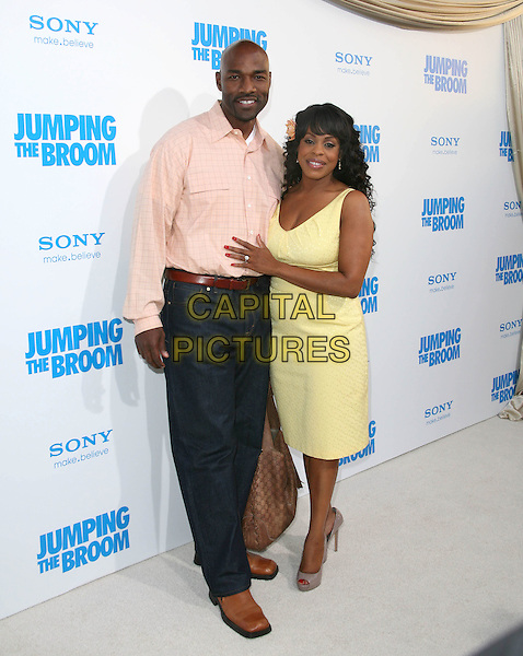 JAY TUCKER  & NIECY NASH .at The Screen Gems L.A. Premiere of Jumping the Broom held at The Cinerama Dome Theatre in Hollywood, California, USA, May 4th 2011..full length couple  yellow dress shirt jeans .CAP/RKE/DVS.©DVS/RockinExposures/Capital Pictures.