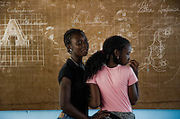 Haitian girls in front of the blackboard in Saint Claire, the education and feeding center run by a Christian organization in Port-au-Prince, Haiti, July 8, 2008.