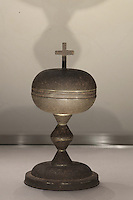 Ciborium, 17th century, which belonged to Barthelemy Codaute, priest of Feuillade in Charente, who used this in clandestine masses after he was outlawed after refusing to take an oath to the Civil Constitution of the Clergy in 1790, in the Upper Chapel, themed as 'L'Engagement' or Commitment, in Le Tresor de la Cathedral d'Angouleme, in Angouleme Cathedral, or the Cathedrale Saint-Pierre d'Angouleme, Angouleme, Charente, France. The 12th century Romanesque cathedral was largely reworked by Paul Abadie in 1852-75. In 2008, Jean-Michel Othoniel was commissioned by DRAC Aquitaine - Limousin - Poitou-Charentes to display the Treasure of the Cathedral in some of its rooms, which opened to the public on 30th September 2016. Picture by Manuel Cohen
