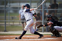 Western Connecticut Colonials catcher Zach Sagar (26) at bat in front of catcher Garrett Bogucki during the second game of a doubleheader against the Edgewood College Eagles on March 13, 2017 at the Lee County Player Development Complex in Fort Myers, Florida.  Edgewood defeated Western Connecticut 3-1.  (Mike Janes/Four Seam Images)