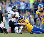 BROOKINGS, SD - SEPTEMBER 20:  Jesse Bobbit #7 from South Dakota State brings down Jayden Essman #16 from Wisconsin-Oshkosh in the first half of their game Saturday at Coughlin Alumni Stadium in Brookings. (Photo/Dave Eggen/Inertia)
