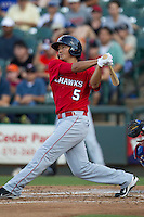 Oklahoma City RedHawks designated hitter Che-Hsuan Lin (5) follows through on his swing during the Pacific Coast League baseball game against the Round Rock Express on July 9, 2013 at the Dell Diamond in Round Rock, Texas. Round Rock defeated Oklahoma City 11-8. (Andrew Woolley/Four Seam Images)