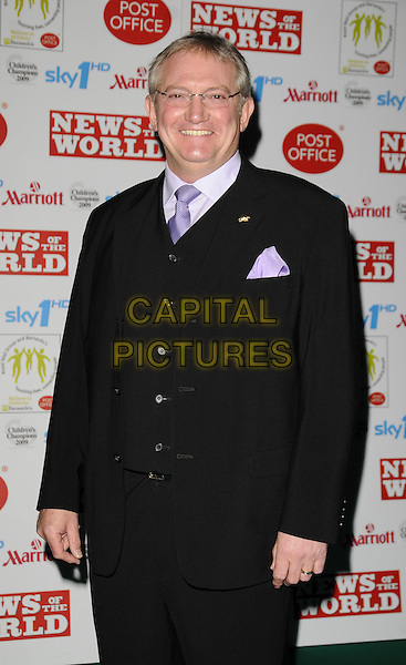GRAHAM COLE.Children's Champions Awards 2009 at the Grosvenor House Hotel, Park Lane, London, England..March 4th 2009.half length 3/4 black suit purple tie hankerchief glasses .CAP/CAN.©Can Nguyen/Capital Pictures.